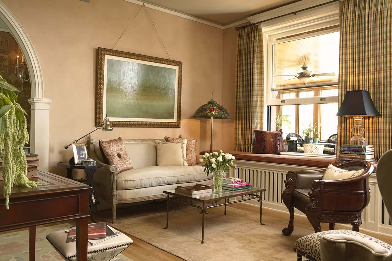 The sitting room's comfortable conversation corner offers an opportunity for relaxation. The honey-toned hard wood floors run throughout the suite (except for the bathroom), softened with pretty rugs. Cream or white woodwork is also the norm.