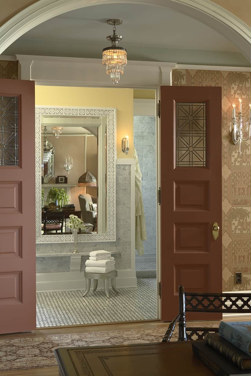 A large mirror hung opposite the bathroom door reflects the sitting room. It's frame is in intricate geometrics, complementing the suite's art glass.