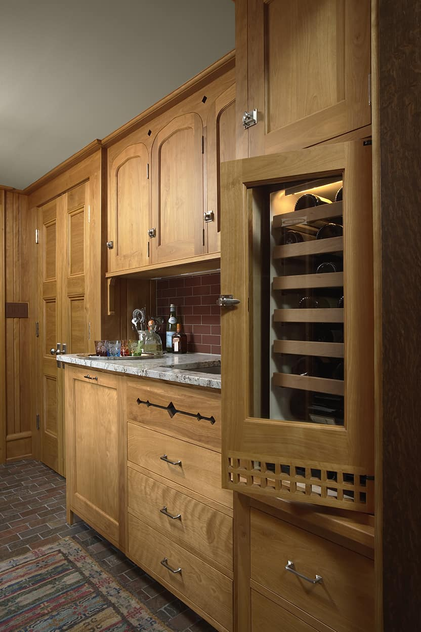 The butlery bar, complete with sink and wine fridge. This shows off the rounded tops of the butlery's cabinetry.