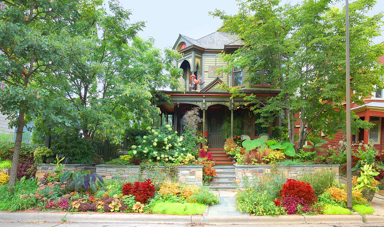This newly gorgeous Queen Ann house sits in harmony with its lush and wildly colorful garden surroundings, bordered by a multi-colored stone wall and stairs. Together they offer a feast for the eyes on even the cloudiest of days.