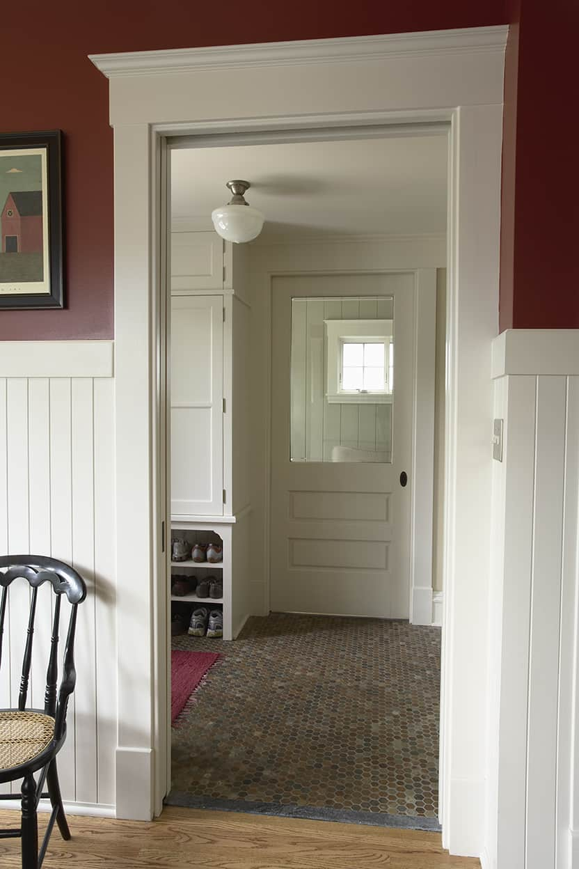 Mudroom with storage and back entry with pocket door