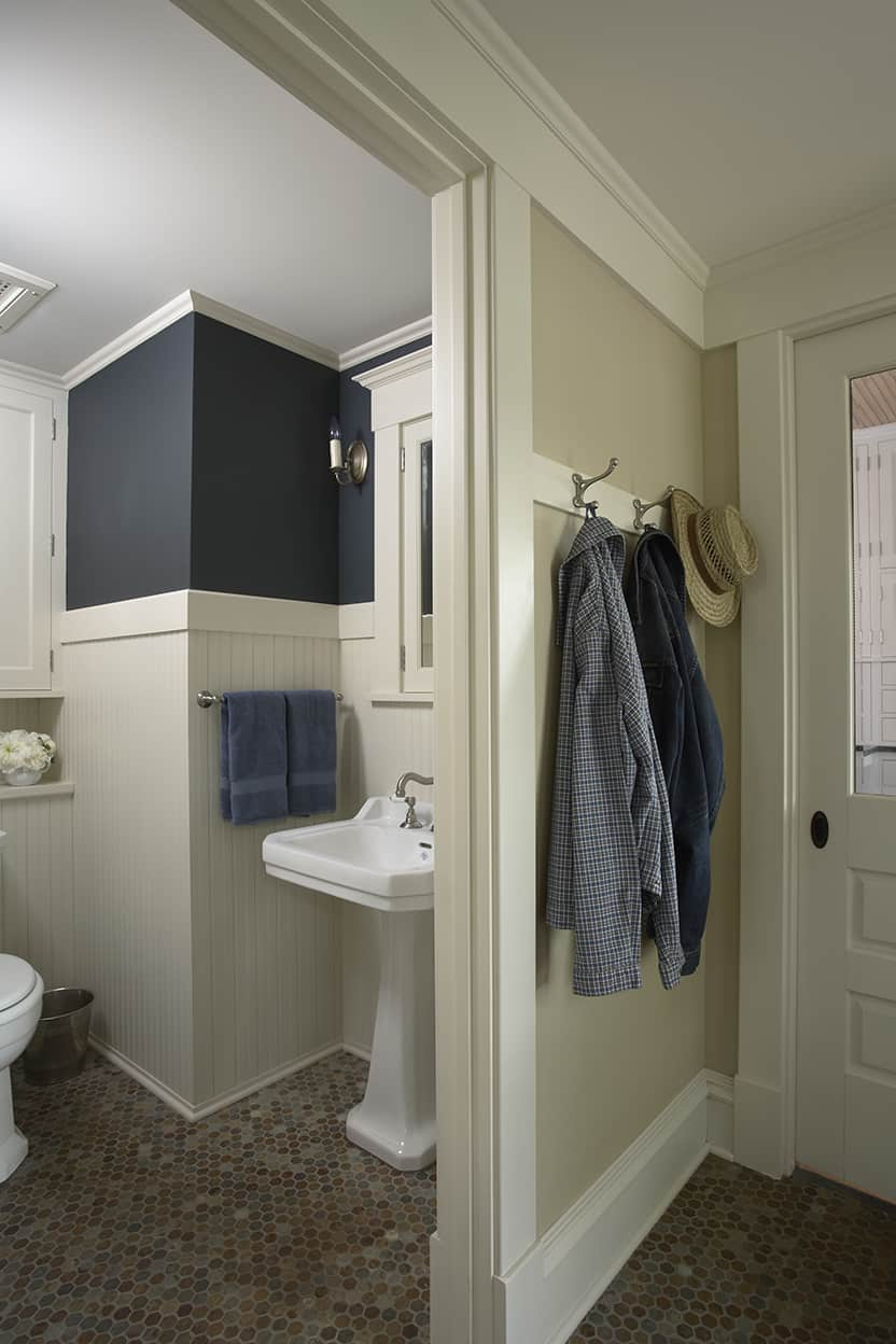 Blue and white powder room and back entry with hexagonal mosaic tile floor in muted browns and blues