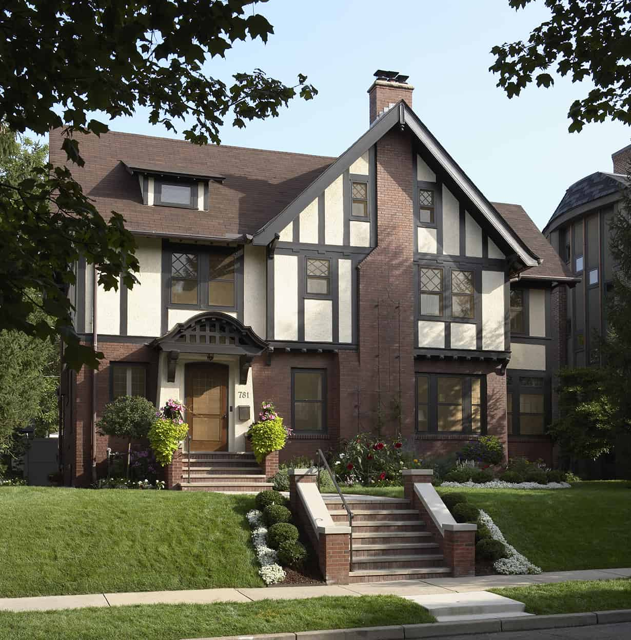 This house is the epitome of American Tudor, with it's blend of brick and half-timber, prominent chimney, striking gable, diamond-paned windows, and modest entry. An elegant and welcoming house.