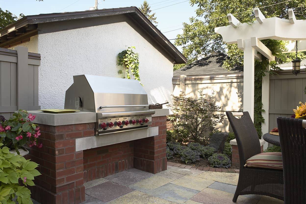The outdoor cooking area has an impressive built-in gas grill.