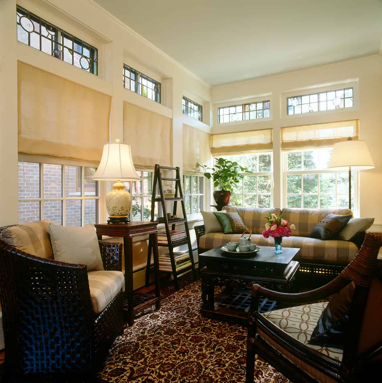 The sunroom has more of that delightful colored art glass above the generous windows and comfortable furniture. A wonderful place to soak up the sun on a winter's afternoon.