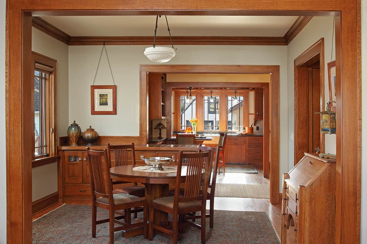 View from the living room through the dining room, back entry, and the kitchen out to the back yard. A restful combination of pale colors, honey-toned wood, and nesting square-arched entranceways, all gilded by bountiful natural light.