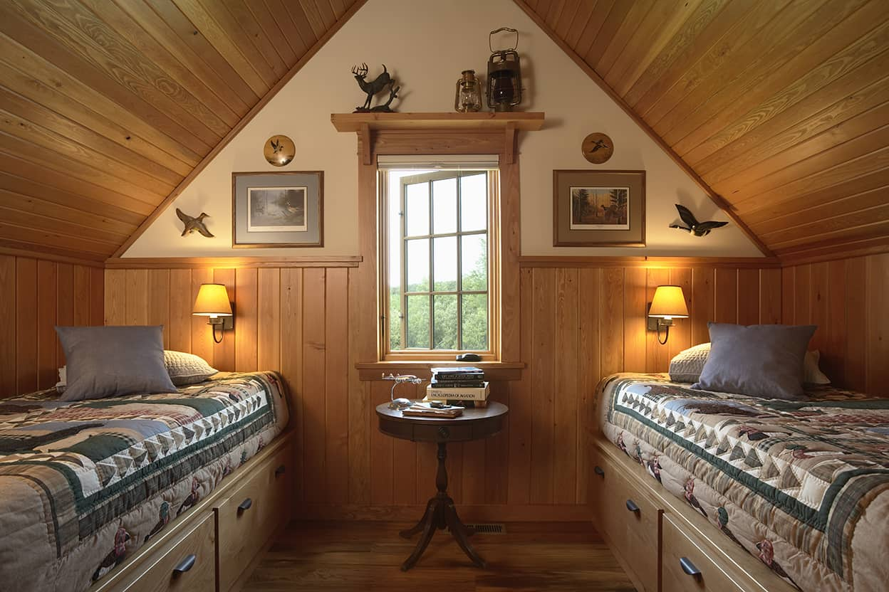 One of the bunkrooms has two single beads with storage underneath; efficient yet cozy.