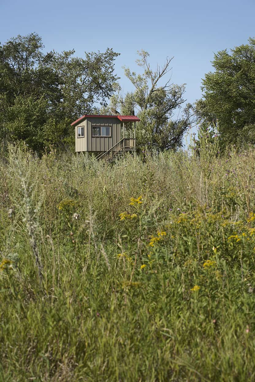 Even the property's deer stand coordinates with the main house, and stands amidst wild prairie.