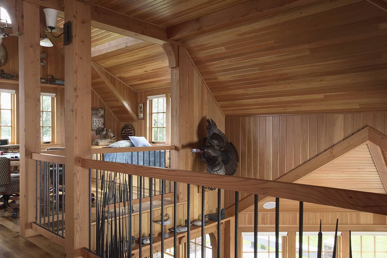 The decor is an homage to hunting and the natural world, like this stuffed turkey taking flight over the top of the stairs.