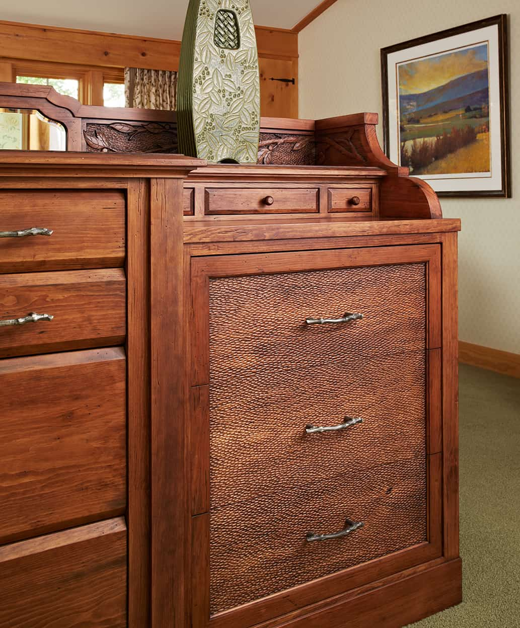 Master bedroom bureau, darker wood with meticulous detail and plenty of drawers with metal twig-shaped pulls