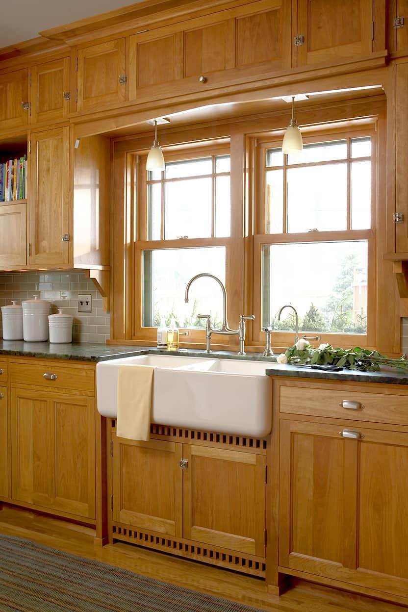 Kitchen white farmhouse sink under a window