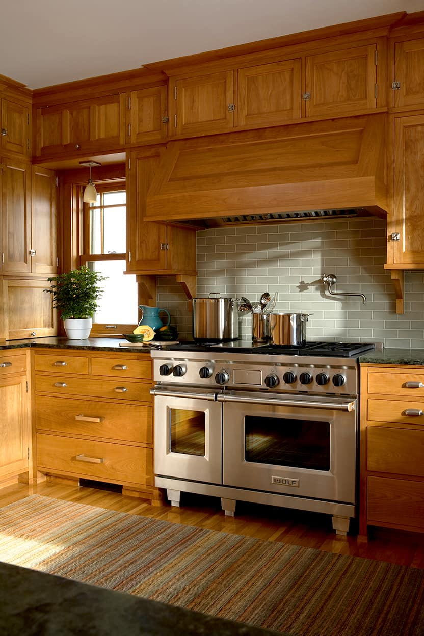 Kitchen chef-quality, stainless steel stove with a potfiller
