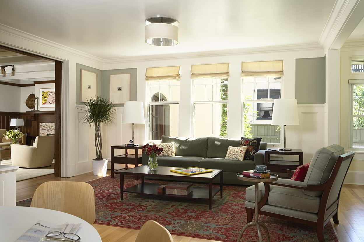 The family room's white painted wood work and panelling, flat ceiling, and stronger wall colors create a more informal air in the family and dining rooms.