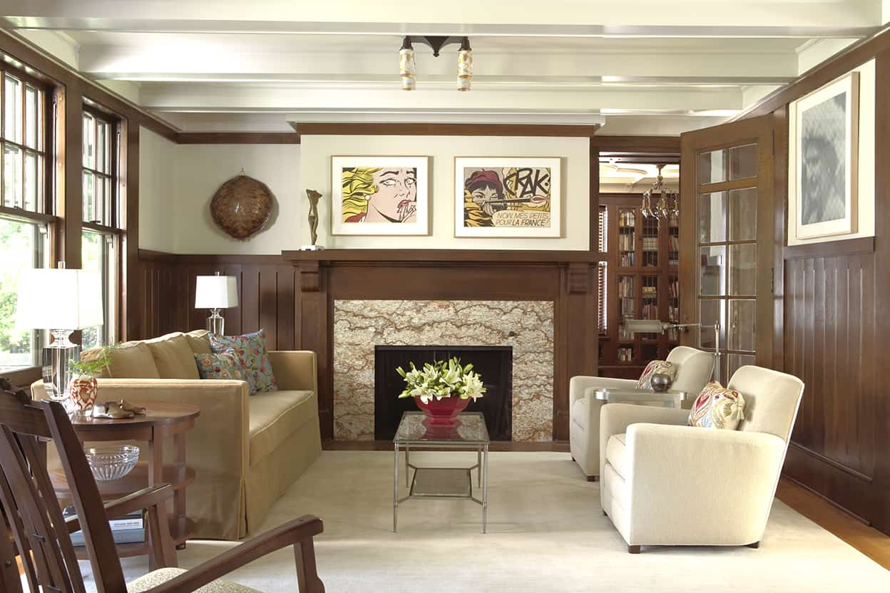 The wood light dark woods combination extends into the neighboring living room, with it's beautiful fireplace.