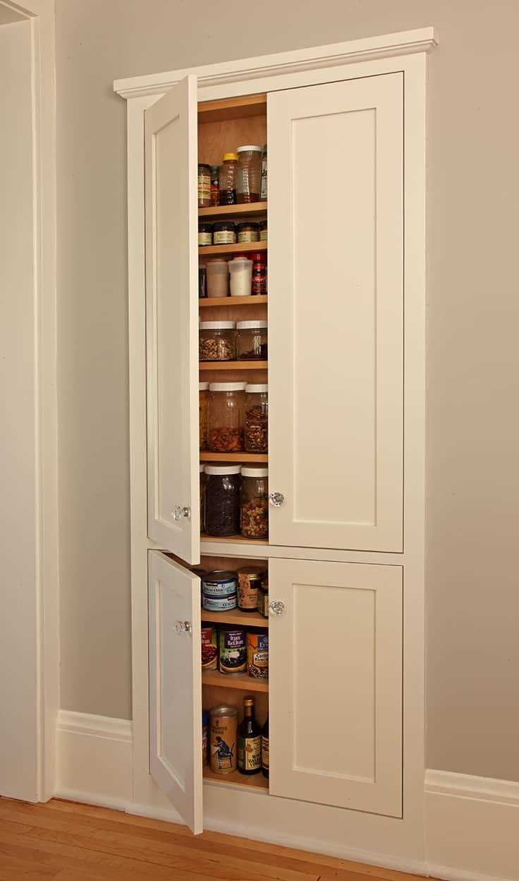 Dry goods pantry with open doors.