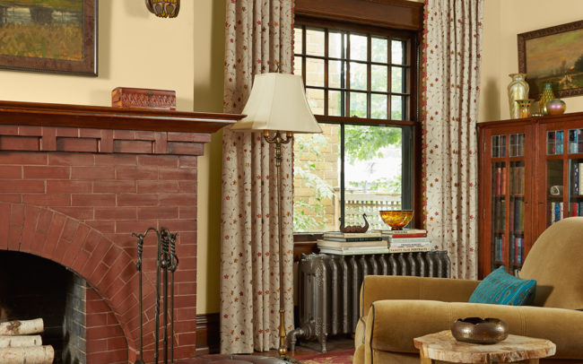 Fire place, window detail, and ottoman