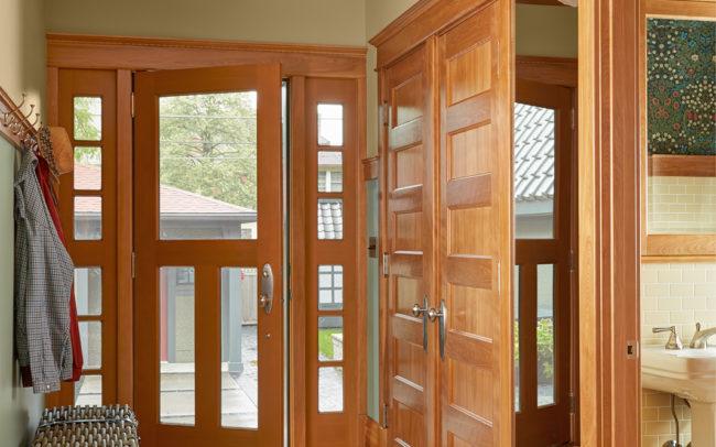 mudroom corridor with pocket door