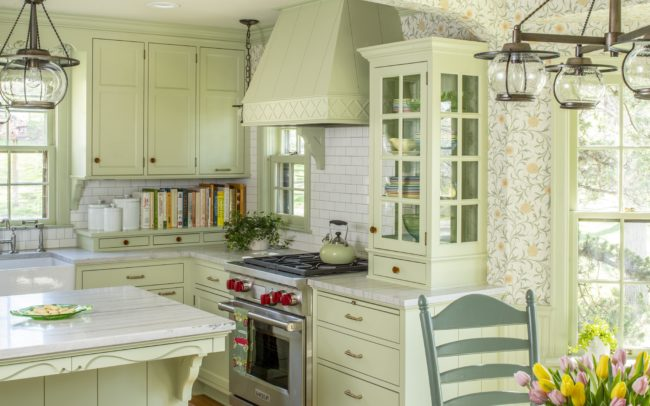 Cozy light-green kitchen with floral wallpaper, marble counters, and white subway tile backsplash. Minnetonka Charmer.