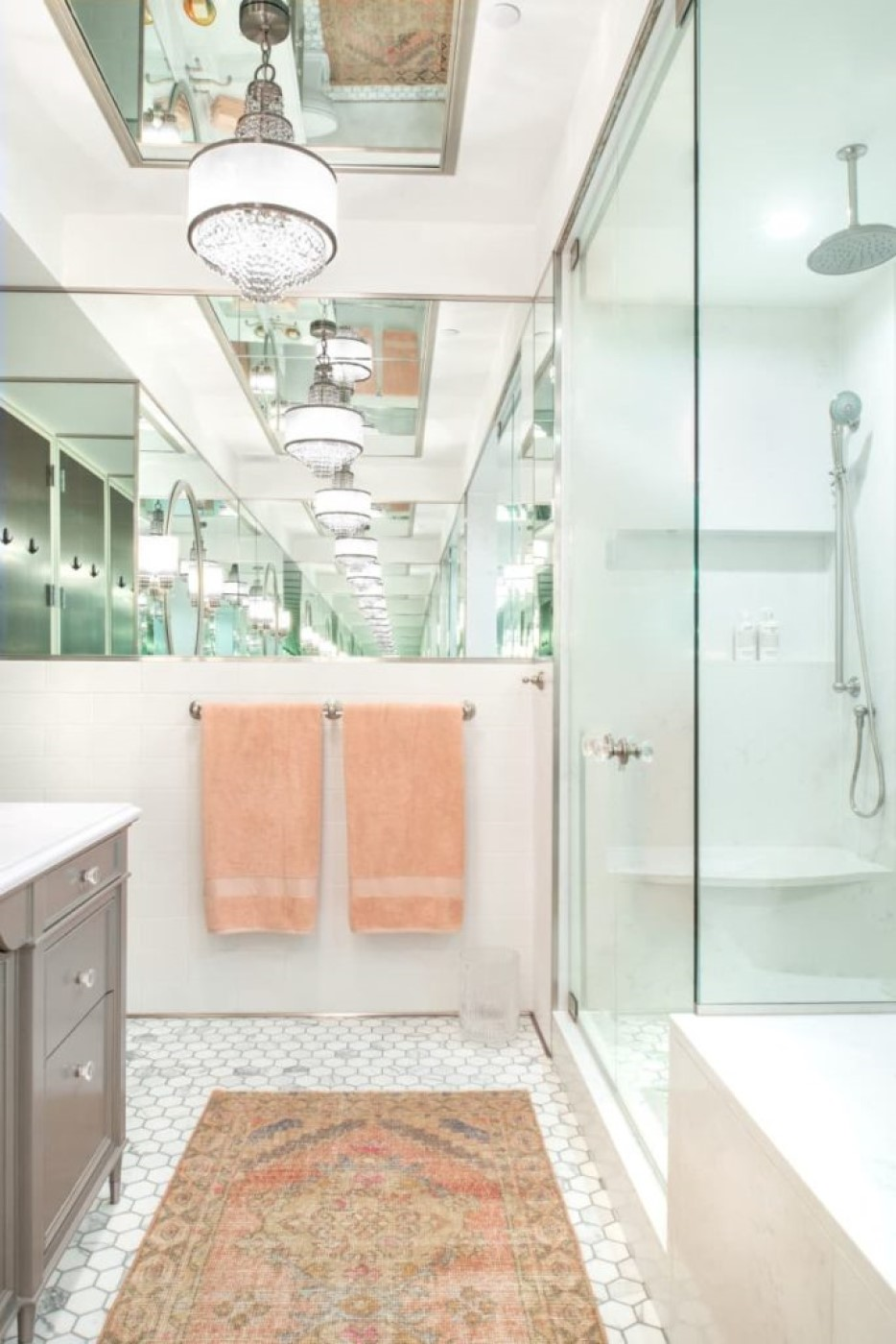 Because of the multitude and placement of the mirrors, you get an infinity mirror effect, reflecting the bathroom's luxurious details again and again and again.